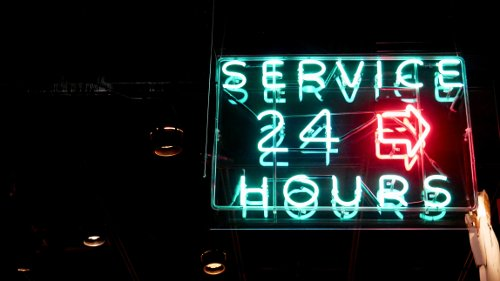 neon sign showing 24 hour service
